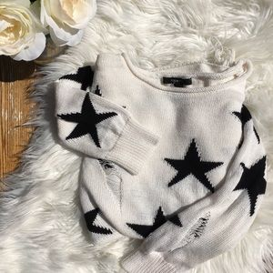 Distress white knitted sweater with black stars